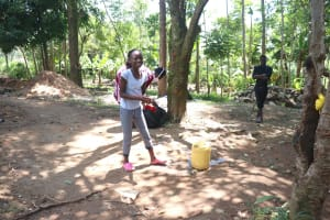 The Water Project: Mwinaya Community, Severe Spring -  Young Girl Demonstrates How To Wash Hands