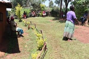 The Water Project: Mutambi Community, Kivumbi Spring -  A Community Leader Addressing The Group
