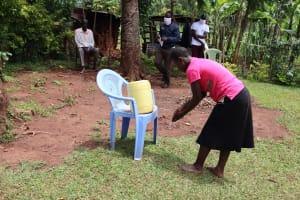 The Water Project: Mutambi Community, Kivumbi Spring -  A Community Member Demonstrating Handwashing