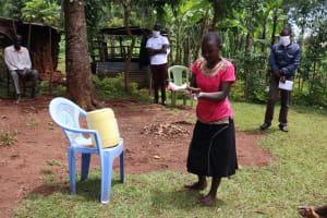 The Water Project: Mutambi Community, Kivumbi Spring -  Handwashing Demonstration