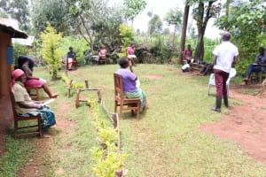 The Water Project: Mutambi Community, Kivumbi Spring -  Mr Wagaka Leading A Demonstration