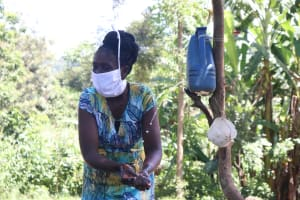 The Water Project: Eshiakhulo Community, Omar Sakwa Spring -  The Facilitator Cleaning Her Hands During The Demonstration