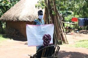 The Water Project: Eshiakhulo Community, Omar Sakwa Spring -  The Facilitator Holding Up The Chart