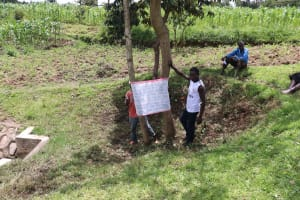 The Water Project: Futsi Fuvili Community, Shikanga Spring -  Community Members Mounting The Chart At The Spring
