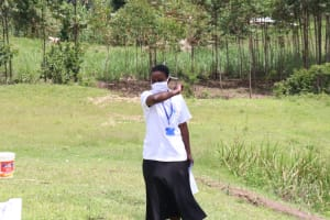 The Water Project: Futsi Fuvili Community, Shikanga Spring -  Ensure That You Cough Into Your Elbows Like This