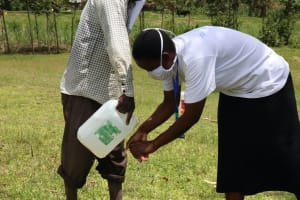 The Water Project: Futsi Fuvili Community, Shikanga Spring -  Ensure That You Rinse Your Hands With Clean Running Water