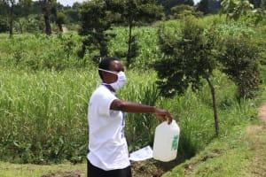 The Water Project: Futsi Fuvili Community, Shikanga Spring -  Mrs Amulavu Urged The Community Members To Make Simple Handwashing Stations To Keep Their Homes Safe