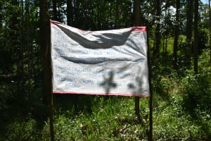 The Water Project: Mkunzulu Community, Museywa Spring -  Reminder Chart Installed At The Spring