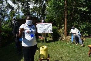 The Water Project: Mkunzulu Community, Museywa Spring -  Stella Inganji Conducting Sensitization Training
