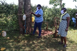 The Water Project: Mtao Community, Tifina Odari Spring -  Demonstrating How To Use The Handwashing Point