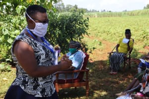 The Water Project: Mtao Community, Tifina Odari Spring -  Jacky Conducting Covid Sensitization Training