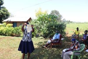 The Water Project: Mtao Community, Tifina Odari Spring -  Making Homemade Masks Demonstration