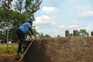 The Water Project:  Field Officer Patience Supervises Interior Plastering