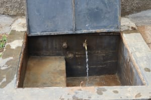 The Water Project:  Water Flowing From Rain Tank Tap