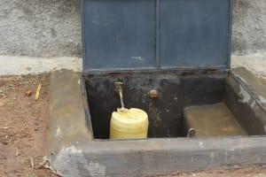 The Water Project: Mukoko Baptist Primary School -  Water Flowing Rom The Rain Tank