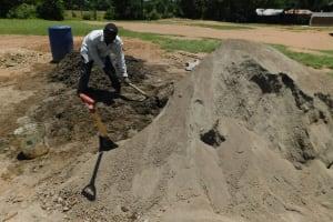 The Water Project: Mukoko Baptist Primary School -  Mixing Concrete