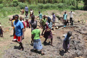 The Water Project: Mukhonje Community, Mausi Spring -  Bringing Stones For Backfilling
