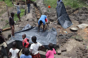 The Water Project: Mukhonje Community, Mausi Spring -  Polythene Tarp Backfilling