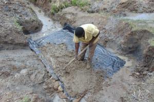 The Water Project: Mukhonje Community, Mausi Spring -  Foundation Slab Laying