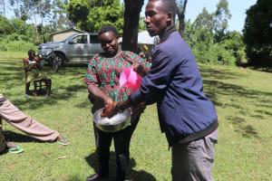 The Water Project: Mukhonje Community, Mausi Spring -  Facilitator Demonstrating Handwashing
