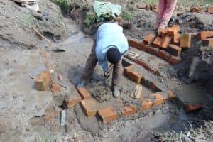 The Water Project: Mukhonje Community, Mausi Spring -  Bricks Setting
