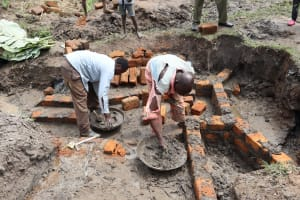 The Water Project: Mukhonje Community, Mausi Spring -  Wall Construction