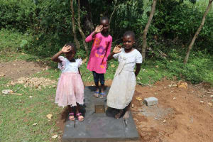 The Water Project: Mukhonje Community, Mausi Spring -  Emma And Her Sisters On A Completed Sanplat