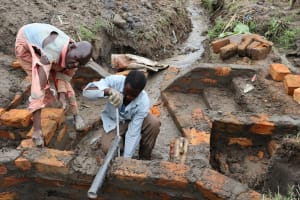 The Water Project: Mukhonje Community, Mausi Spring -  Pipe Setting