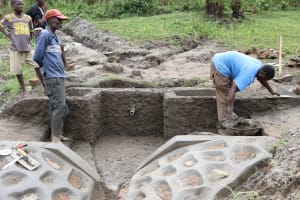 The Water Project: Mukhonje Community, Mausi Spring -  Outside Plaster