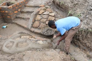 The Water Project: Mukhonje Community, Mausi Spring -  Stone Pitching
