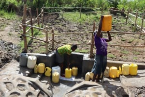 The Water Project: Mukhonje Community, Mausi Spring -  Community Member Ferrying Water