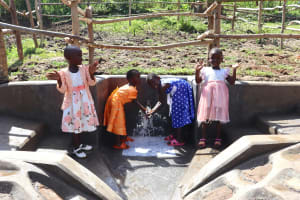 The Water Project: Mukhonje Community, Mausi Spring -  Girls Celebrating Water