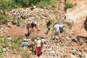 The Water Project: Nzimba Community -  Working On The Top Of The Walls