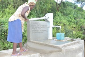 The Water Project: Nzimba Community A -  Pumping The Completed Well