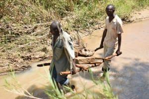 The Water Project: Nduumoni Community A -  Hauling Rocks
