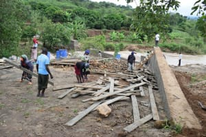 The Water Project: Nduumoni Community -  Removing Boards From Dam
