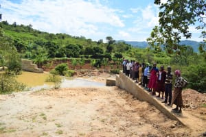 The Water Project: Nduumoni Community -  Lined Up At The New Dam