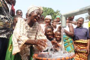 The Water Project: Lungi, Rosint, #26 Old Town Road -  Old Woman Celebrates At The Well