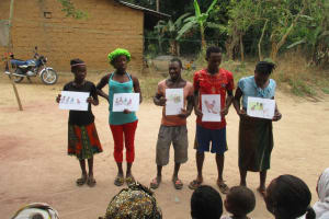 The Water Project: Lungi, Rosint, #26 Old Town Road -  Participants Displaying Disease Transmission Story Posters