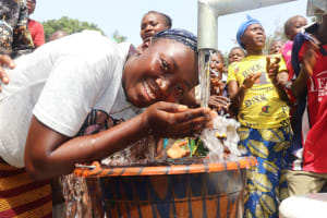 The Water Project: Lungi, Rosint, #26 Old Town Road -  Young Girl Drinks From The Well