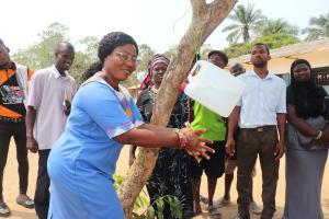 The Water Project: Lungi, Madina, St. Mary's Junior Secondary School -  School Principal Demonstrating Handwashing Method