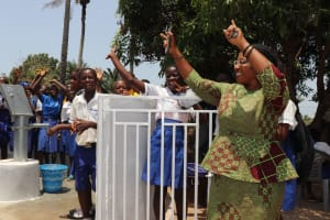 The Water Project: Lungi, Madina, St. Mary's Junior Secondary School -  School Principal Celebrating With Students For Safe Drinking Water