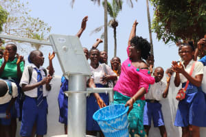 The Water Project: Lungi, Madina, St. Mary's Junior Secondary School -  School Teacher And Student Celebrating For Safe Drinking Water Provide Forthe At Their School