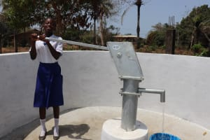 The Water Project: Lungi, Madina, St. Mary's Junior Secondary School -  Student Happy Collecting Safe Drinking Water