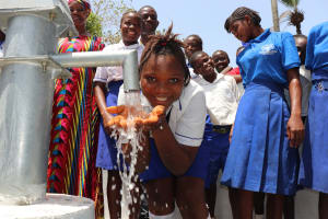 The Water Project: Lungi, Madina, St. Mary's Junior Secondary School -  Student Happy Drinking Water