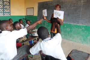 The Water Project: Lungi, Madina, St. Mary's Junior Secondary School -  Students Using Training Materials