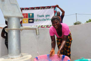 The Water Project: Lungi, Thomossoh, #24 Thullah Street -  Splashing Water With Banner