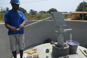 The Water Project: Lungi, Thomossoh, #24 Thullah Street -  Testing After Finished Installing Pump
