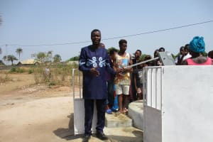 The Water Project: Lungi, Thomossoh, #24 Thullah Street -  Ward Councilor Abu Koroma Advising Community Members To Take Great Care Of The Pump