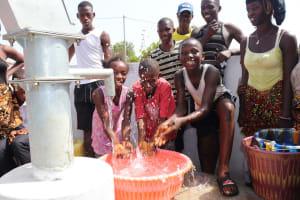The Water Project: Lungi, Thomossoh, #24 Thullah Street -  Kids Splashing Water